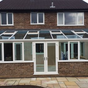 Large conservatory spanning the full length of a home completed by A. Woodhall Building Contractors